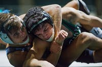 Ohio red shirt junior Noah Forrider is held in a lock by Old Dominion's Chris Mecate during a match on Feb. 7. OU lost the match 3-1. (FILE)