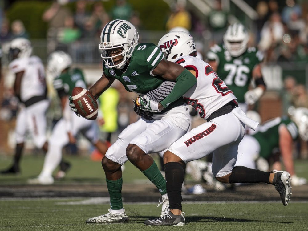 Ohio University wide receiver, Shane Hooks (#5) attempts to shake Northern Illinois University defense during the home game on Saturday, Oct. 12, 2019.