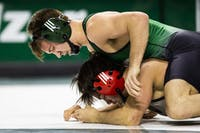 Ohio senior Cameron Kelly wrestles SIUE's Lucas Bernal during a match Feb. 9 in The Convo.
