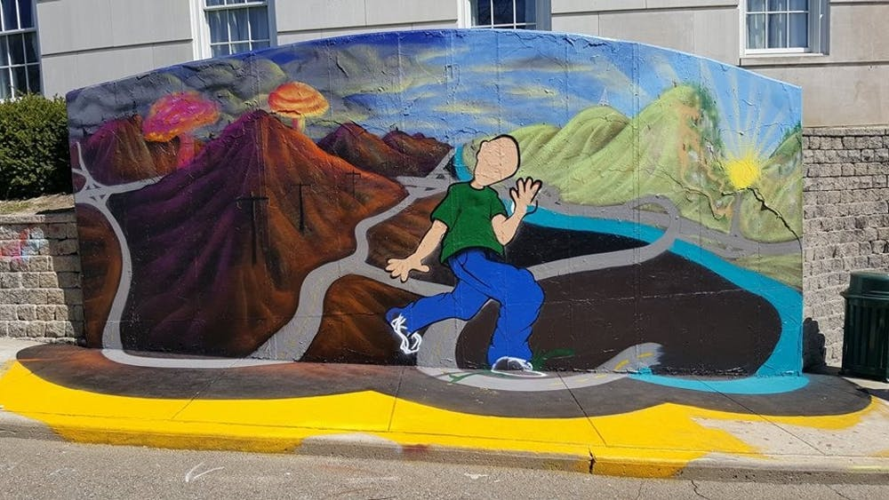 After 18 hours and $250, Athens resident's mural hastily covered