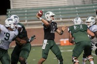 Quarterback, Nathan Rourke (#12), passes the ball during the green and white scrimmage on Saturday, August 18, 2019 in Athens, Ohio. The football team is gearing up for the season to start on August 31 against Rhode Island.