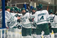 Ohio senior forward Matt Rudin (#27) celebrates with the bench after scoring a short-handed goal in the first period of the Bobcat's 12-0 win over Pitt on Friday, Jan. 18, 2019.