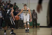 Athens High School senior Griffin Lutz (#3) dribbles down the court during the Bulldog's 81-47 win over River Valley.