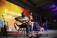 (From left to right) Arun Saha, Anirban Biswas, Debanjan Chakraborty and Prasenjit Shome perform with Srirupa Gupta (not pictured) as the band Chhannochhara at the Bangladeshi Cultural Night in Athens, Ohio, on Oct. 20, 2019.
