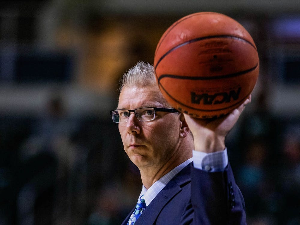 Jeff Boals, the new Head Coach for the Ohio Bobcats men's basketball team, catches the ball after it bounces out of bounds in the first match of the season against Capital University in the Convocation Center on Saturday, Nov. 2, 2019