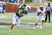 Ohio's QB Nathan Rourke (12) runs with the ball in a play against Kent State held at Peden Stadium on Saturday, Oct. 19, 2019.