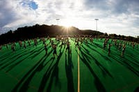 The Marching 110 goes over formations during practice at Pruitt Field. (FILE)