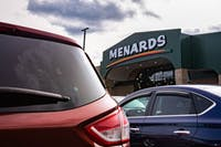 Cars and trucks fill the parking lot outside Menards as excited customers make the most of its grand opening on State Street in Athens, Ohio, on Monday, Sept. 14, 2020.