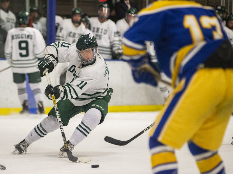 Ohio defenseman Jacob Houston (#11) controls the puck during the Bobcats' game on Friday, Feb. 21, 2020, in Bird Arena.