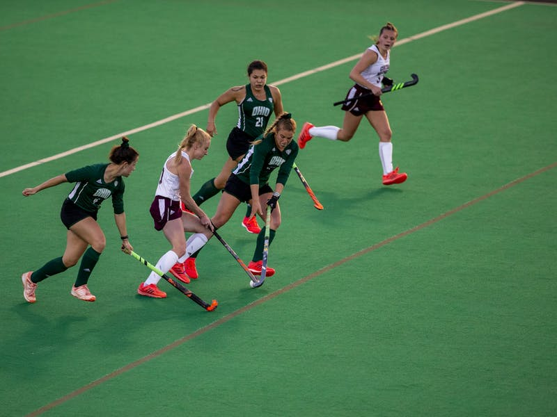 Ohio University field hockey players fight against Western Michigan University for the ball during the home game on Friday, March 26, 2021 in Athens, Ohio.