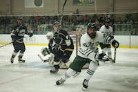 Ohio forward Andrew Wells (No.20) racing for the puck against John Carroll forward Joe Lane (No. 4) on Friday, Sept. 27, 2019 at Bird Arena in Athens, Ohio.