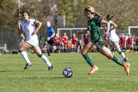 Ohio University's Sydney Leckie (No. 18) dribbles the ball toward the goal during the game against Eastern Michigan on Sunday, Oct. 20, 2019. (FILE)