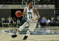 Ohio senior guard Mike Laster (#24) scans the court during the first half of the Bobcats' game against Bowling Green on Tuesday, Feb. 27.