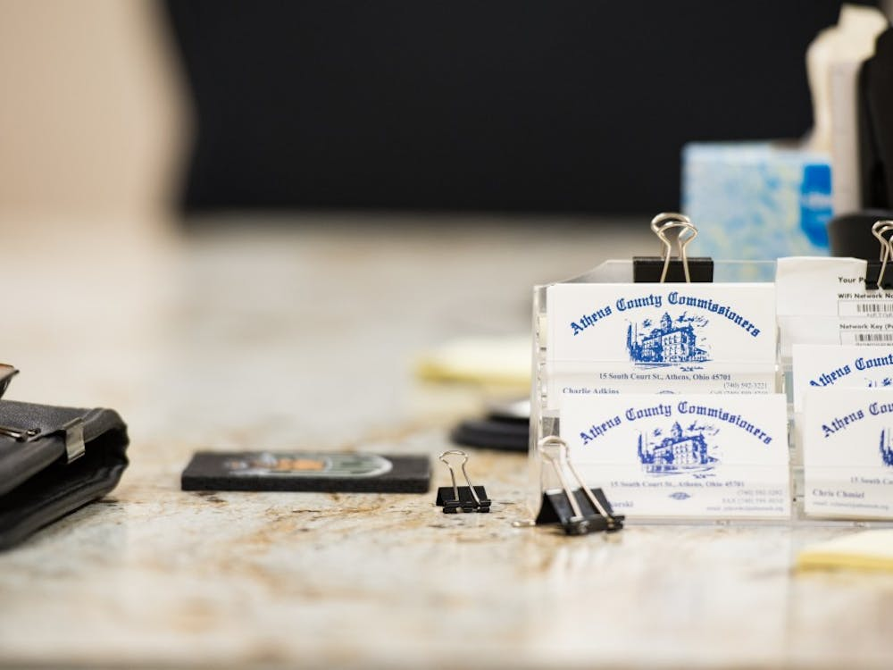A stack of Athens County Commissioners business cards rest on a table during a meeting on January 29, 2019.