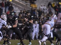 Ohio University offensive linemen protect quarterback, Nathan Rourke against Western Michigan University. (FILE)