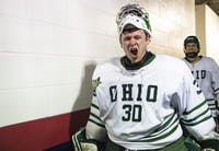 Ohio goalie Jimmy Thomas yells in excitement with his teammates after the Bobcats' game against UNLV in the 2018 ACHA National Tournament on March 9. The Bobcats beat the Rebels 3-2 in overtime.