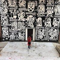 Instagram user lizvonhoene poses near the Seigfred mural.