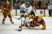 Ohio defenseman Thomas Pokorney (#4) handles the puck with pressure from Iowa State defenseman Kurt Halbach (#24) during the second period of the Bobcats' game against the Cyclones on Friday, Feb. 15, 2019, at Bird Arena.