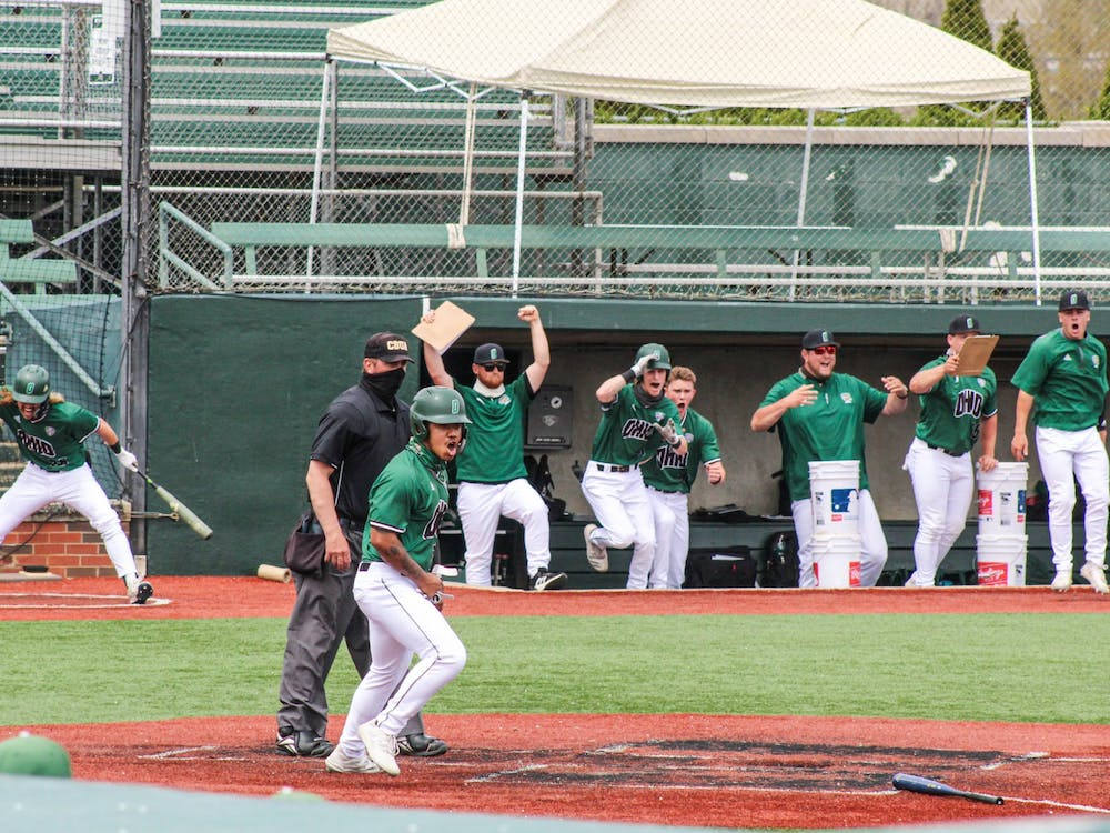 Ohio's team cheers during their successful game against Eastern Michigan on Saturday, April 10, 2021.