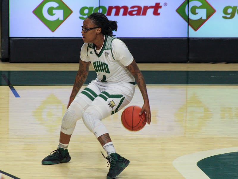 Ohio University guard, Erica Johnson (4), dribbles the ball at the top of the key during the home game against University at Buffalo on Wednesday, Jan. 20, 2021 in Athens, Ohio.