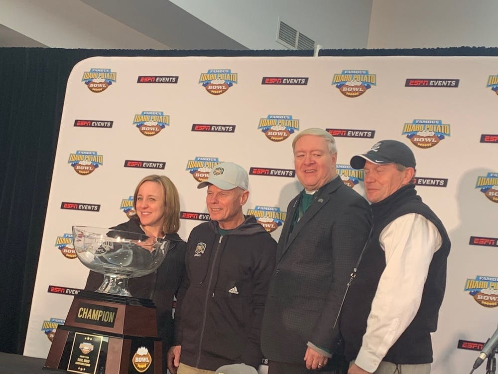 Frank Solich (second to the left) stands with Ohio University athletic director Julie Cromer, OU president Duane Nellis and Mid-American Conference commissioner Jon Steinbrecher following the Bobcats' win in the 2020 Famous Idaho Potato Bowl.