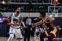 Ohio guard Jordan Dartis (No. 35) looks for a pass as he dodges Central Michigan's guard Dallas Morgan (No. 23) in a conference match held at the Convo on Tuesday, Feb. 18, 2020.
