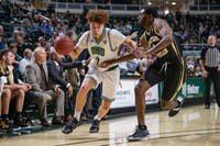 Ohio's Jason Preston dribbles the ball past Western Michigan's Adrian Martin during their game on Tuesday, Feb. 11, 2020, in The Convocation Center.