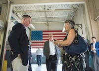 Rep. Steve Stivers (left), R-Upper Arlington, talks with a rehabilitation industry worker during his visit to the Hocking Correctional Facility on Friday.