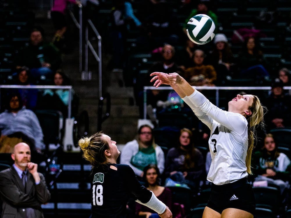 Ohio's outside hitter Lizzie Stephens (No. 3) reaches for the ball in a match against Akron held at The Convo on Nov. 16, 2019. (FILE)