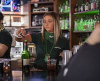 Mackenzie Conroy works at Courtside Pizza for Green Beer Day on Wednesday, March 4, 2020.