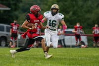 Alexander's Michael Lash II attempts to run the ball past Athens' Braxton Springer during the game at Alexander High School on Friday, Aug. 28, 2020. Athens beat Alexander 20-13.