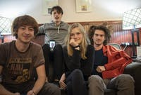 (Left to right) Harper Reese, Shea Benezra, Cora Fitch and Mitch Spring of Velvet Green — joined by bandmate Sam Debatin on FaceTime — pose for a portrait in Donkey Coffee.