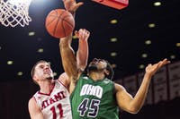 Ohio redshirt junior forward Doug Taylor (#45) sees his dunk get blocked by Miami's Logan McLane during the Bobcats' 68-55 season-ending loss against Miami on March 5.