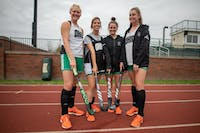 Ohio University field hockey seniors (left to right) Kendall Ballard, Brittany Keen, Amy Edgerton and Karynne Baker pose for a photo at Pruitt Field on Wednesday, Oct. 30, 2019.