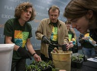 aSustainability Ambassadors Anthony Stanzi (left) and Sam Smith (center) put plants into pots while Ariel Keener (right) watches at an event on reusing planters in Nelson Hall on Tuesday, Nov. 19, 2019.