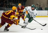 Ohio's Tom Pokorney (#4) handles the puck while playing as a forward during the Bobcats' 2-0 shutout against the Iowa State Cyclones on Saturday, Feb. 16.