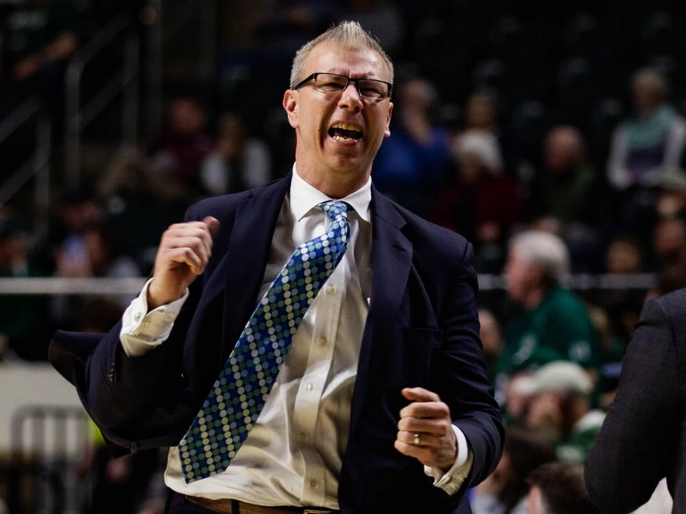 Head coach Jeff Boals cheers during a conference game against Central Michigan University at the Convo on Tuesday, Feb. 18, 2020.