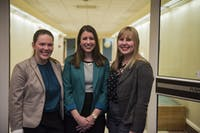 From left to right, vice presidential candidate Hannah Burke, presidential candidate Maddie Sloat and treasurer candidate Lydia Ramlo pose for a portrait before a debate in Stocker Center on March 27. (FILE)