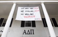 A banner protesting the recent sexual assult hangs at the Alpha Delta Pi sorority house.