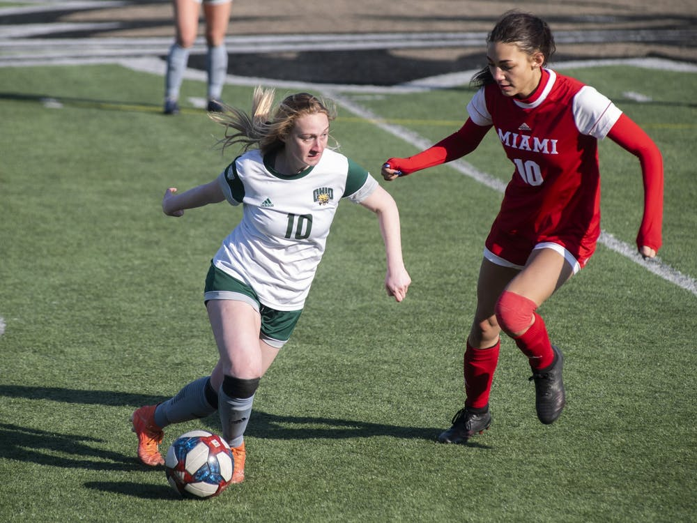 Haley Miller (#10) drives the ball down the field during the Ohio University home game at Peden Stadium in Athens, Ohio, on March 4, 2021. The Bobcats lost to the Redhawks 0-1.