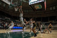 Ohio University's Teyvion Kirk (#4) jumps to dunk the ball during the match versus Western Michigan on Tuesday. The Bobcats won the game 81-76. (FILE)