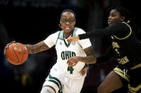 Ohio's Erica Johnson (no.4 ) drives the ball against Eastern Michigan University defense. Bobcats won 84-75 in the first round of the MAC championship game in Cleveland, Ohio, at Rocket Mortgage Field House on March 11th, 2020.