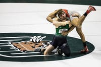 Ohio junior Zach Carson wrestles Justin Ruffin of SIUE during a dual meet Feb. 9 in The Convo.