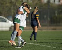 Ohio's Alivia Milesky (11) embraces teammate Abby Townsend (16) after Townsend's goal in the second half of the match between the Bobcats and the Toledo Rockets at Chessa Field on Friday, Oct. 4, 2019.