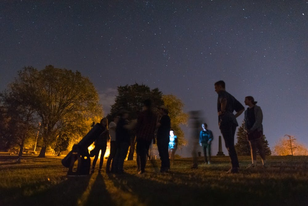 Stargazers escape the light pollution of Athens to peer into the heavens