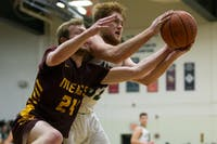 Athens center Justin Hynes (#32) competes for the ball with Meigs guard Cooper Darst (#24) during the first half of the Bulldogs game against the Marauders on Feb. 8. (FILE)