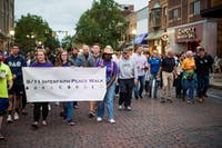 Participants in the eighth annual Interfaith Peace Walk march down Court Street on Tuesday.