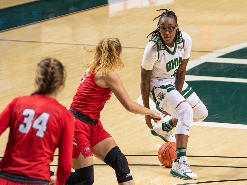 Erica Johnson (#4), of Ohio, dribbles the ball between her legs during Ohio's game versus Liberty on Wednesday, Nov. 25, 2020, in The Convo. Ohio won 76-72.
