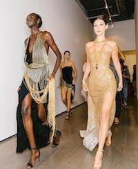 Models Bella Hadid and Subah Koj on their way to Oscar de la Renta's runway show. (Photo via @oscardelarenta on Instagram)