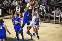 Ohio guard Cece Hooks (#1) attempts a shot on Taylor Sutton (#2) during the second half of the Bobcats game on Sunday, March 24, 2019, at the Convo Center in Athens, Ohio. The Bobcats beat the Raiders 59-57 in the second round of the Women's National Invitational Tournament.